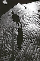 Man standing on cobblestone street<br />