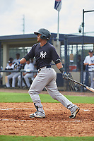 GCL Yankees West center fielder Luis Martinez (8) follows through on a swing during the first game of a doubleheader against the GCL Yankees East on July 19, 2017 at the Yankees Minor League Complex in Tampa, Florida.  GCL Yankees West defeated the GCL Yankees East 11-2.  (Mike Janes/Four Seam Images)