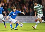 St Johnstone v Celtic...07.05.14    SPFL<br /> David Wotherspoon is closed down by Charlie Mulgrew<br /> Picture by Graeme Hart.<br /> Copyright Perthshire Picture Agency<br /> Tel: 01738 623350  Mobile: 07990 594431