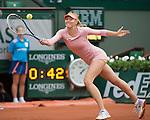 Maria Sharapova (Rus) defeats Ksenia Pervak (Rus) 6-1, 6-2 at  Roland Garros being played at Stade Roland Garros in Paris, France on May 26, 2014