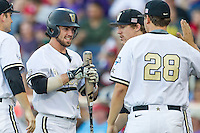 Vanderbilt Commodores shortstop Dansby Swanson (7) celebrates after scoring against the TCU Horned Frogs in Game 12 of the NCAA College World Series on June 19, 2015 at TD Ameritrade Park in Omaha, Nebraska. The Commodores defeated TCU 7-1. (Andrew Woolley/Four Seam Images)