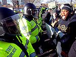 (Boston, Ma 121314) Protesters confront police on the street in front of the Suffolk Sheriff County Department, Saturday in Boston. Jim Michaud Photo