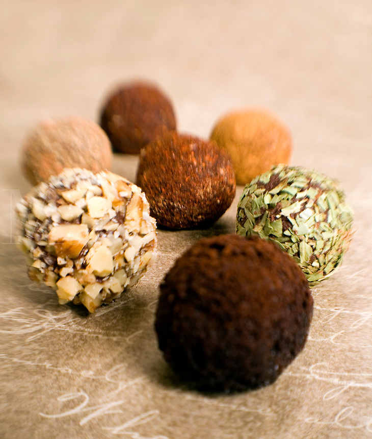 Chocolate Truffles on gold rolles in Spices