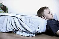 Junge und sein Bett (Matratze), Hartz IV, Bochum<br /> <br /> *** HighRes auf Anfrage *** Voe nur nach Ruecksprache mit dem Fotografen *** Sonderhonorar ***<br /> <br /> Engl.: Europe, Germany, Bochum, unemployment benefit, Hartz IV, unemployed, unemployment, poverty, poor, social benefits, boy, bed, mattress, portrait, 28 March 2012<br /> <br /> ***Highres on request***publication only after consultation with the photographer***special fee***
