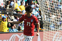 South Korea midfielder Chung Yong Lee celebrates his stoppage time goal at the end of the first half. Argentina defeated South Korea, 4-1, in both teams' second match of play in Group B of the 2010 FIFA World Cup. The match was played at Soccer City in Johannesburg, South Africa June 17th.