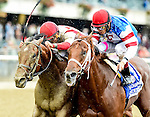ELMONT, NY - OCTOBER 08: Practical Joke #1 (left), ridden by Joel Rosario, catches Syndergaard #3, ridden by John Velazquez at the wire to win by a nose in the Champagne Stakes on Jockey Club Gold Cup Day at Belmont Park on October 8, 2016 in Elmont, New York. (Photo by Scott Serio/Eclipse Sportswire/Getty Images)