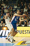 Real Madrid´s Rudy Fernandez and Anadolu Efes´s Furkan Korkmaz during 2014-15 Euroleague Basketball match between Real Madrid and Anadolu Efes at Palacio de los Deportes stadium in Madrid, Spain. December 18, 2014. (ALTERPHOTOS/Luis Fernandez)