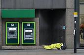 Rough sleeper outside Lloyds Bank, Moorgate, Islington, London.