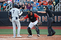 Pablo Olivares (7) of the Hudson Valley Renegades is tagged out by Aberdeen IronBirds catcher Christopher Burgess (24) as home plate umpire Adam Pierce makes the call at Leidos Field at Ripken Stadium on July 23, 2021, in Aberdeen, MD. (Brian Westerholt/Four Seam Images)