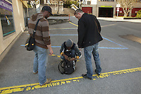"""Switzerland. The Republic and Canton of Neuchâtel. Fontainemelon. Narcotics squad. """"Narko"""" operation. Two police officers on duty (both in plain-clothes)  control the identity of a man from Western Africa. The policemen look for illegal substances (drugs). The black men will be left free at the end of the control. Plainclothes law enforcement is a method used by police. The policemen wear plainclothes or """"ordinary clothes"""" instead of a uniform in order to avoid detection or identification as law enforcement agents. Police officers in plainclothes must identify themselves when using their police powers. Fontainemelon is a former municipality in the district of Val-de-Ruz.9.04.15 © 2015 Didier Ruef"""
