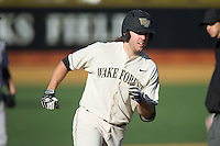 Will Craig (22) of the Wake Forest Demon Deacons rounds third base after hitting his second home run of the game against the Richmond Spiders at David F. Couch Ballpark on March 6, 2016 in Winston-Salem, North Carolina.  The Demon Deacons defeated the Spiders 17-4.  (Brian Westerholt/Four Seam Images)