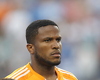 Houston Dynamo defender Jermaine Taylor (4). In a Major League Soccer (MLS) match, Houston Dynamo (orange) defeated the New England Revolution (blue), 2-1, at Gillette Stadium on July 13, 2013.