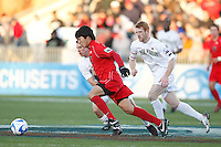 Ohio State Buckeyes midfielder Roger Espinoza (27) is marked by Wake Forest Demon Deacons midfielder Corben Bone (10) and defender Pat Phelan (5). The Wake Forest Demon Deacons defeated the Ohio State Buckeyes 2-1 in the finals of the NCAA College Cup at SAS Stadium in Cary, NC on December 16, 2007.