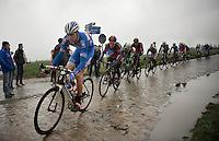 Mirko Selvaggi (ITA) over the cobbles of the Holleweg<br /> <br /> Omloop Het Nieuwsblad 2014