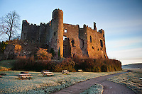 Tuesday 14 January 2014<br /> Pictured:The sun begind to shine on Laugharne Castle on Laugharne, West Wales <br /> Re: A cold start across many parts of the UK caused by Sub zero overnight temperatures