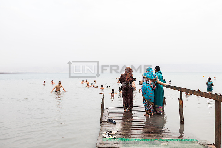 Indian women preceding a dip in the salt waters of the Dead Sea