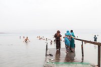 Indian women preceding a dip in the salt waters of the Dead Sea