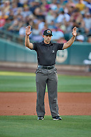 Umpire Alex MacKay handles the calls on the bases during the game between the Salt Lake Bees and the El Paso Chihuahuas at Smith's Ballpark on August 17, 2019 in Salt Lake City, Utah. The Bees defeated the Chihuahuas 5-4. (Stephen Smith/Four Seam Images)