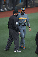 Third base umpire Gary Swanson tried to keep Tennessee Volunteers head coach Tony Vitello (22) away from home plate umpire David Pritchett (not pictured) during the game against the Charlotte 49ers at Hayes Stadium on March 9, 2021 in Charlotte, North Carolina. The 49ers defeated the Volunteers 9-0. (Brian Westerholt/Four Seam Images)