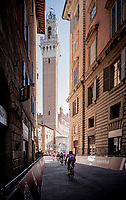 grupetto riders rolling into the Piazza Del campo<br /> <br /> 15th Strade Bianche 2021<br /> ME (1.UWT)<br /> 1 day race from Siena to Siena (ITA/184km)<br /> <br /> ©kramon