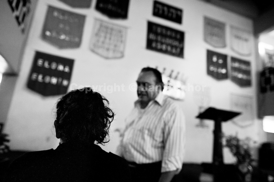 Pastor Hugo Alvarez prepares the exorcism ritual on a follower of the Church of the Divine Saviour in Mexico City, Mexico, 31 May 2011. Exorcism is an ancient religious technique of evicting spirits, generally called demons or evil, from a person which is believed to be possessed. Although the formal catholic rite of exorcism is rarely seen and must be only conducted by a designated priest, there are many Christian pastors and preachers (known as 'exorcistas') performing exorcism and prayers of liberation. Using their strong charisma, special skills and religous formulas, they command the evil spirit to depart a victim's mind and body, usually invoking Jesus Christ or God to intervene in favour of a possessed person.