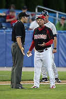 Batavia Muckdogs manager Dann Bilardello #32 argues a call with field umpire John Libka during a game against the Mahoning Valley Scrappers at Dwyer Stadium on July 5, 2011 in Batavia, New York.  Batavia defeated Mahoning Valley 2-1.  (Mike Janes/Four Seam Images)