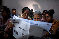 National League of Democracy supporters read newspapers showing Aung San Suu Kyi the day after her release from house arrest in Rangoon. From 1990 until her release on 13 November 2010, Aung San Suu Kyi had spent almost 15 of the 21 years under house arrest.