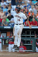 Nate Irving #18 of the Virginia Cavaliers celebrates during Game 4 of the 2014 Men's College World Series between the Virginia Cavaliers and Ole Miss Rebels at TD Ameritrade Park on June 15, 2014 in Omaha, Nebraska. (Brace Hemmelgarn/Four Seam Images)