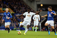 Liverpool, UK. Saturday 01 November 2014<br /> Pictured: Wilfried Bony of Swansea takes a shot at goal but fails to score, against him is Gareth Barry of Everton.<br /> Re: Premier League Everton v Swansea City FC at Goodison Park, Liverpool, Merseyside, UK.