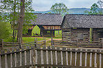 "Great Smoky Mts. National Park, TN/NC<br /> View of a cantilever barn and a log corn crib with a  fence at ""The Tipton place"" farm site in Cades Cove"