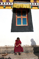 A young Tibetan boy at the Upper Wutan Monastery, Rebgong (Chinese name - Tongren),  on the Qinghai-Tibetan Plateau. China.