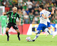 AUSTIN, TX - JUNE 19: Diego Fagundez #14 of Austin FC attempts to block a kick by Oswaldo Alanis #4 of the SJ Earthquakes during a game between San Jose Earthquakes and Austin FC at Q2 Stadium on June 19, 2021 in Austin, Texas.