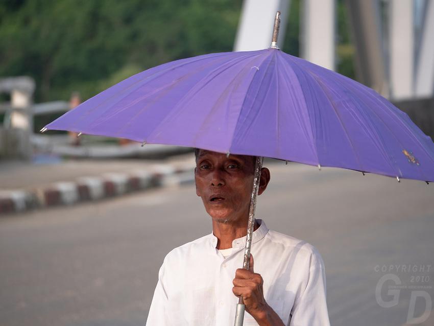 Burmese man with Umbrella, Myanmar, Rakhine State