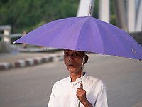 Burmese man with Umbrella, Myanmar, Rakhine State
