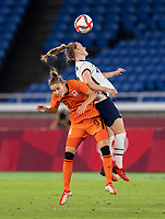 YOKOHAMA, JAPAN - JULY 30: Vivianne Miedema #9 goes up for a header with Becky Sauerbrunn #4 of the USWNT during a game between Netherlands and USWNT at International Stadium Yokohama on July 30, 2021 in Yokohama, Japan.