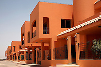 The Al Zawaia Group housing compound in the Soba district of Khartoum. New luxury housing projects such as this, containing shops, creches and swimming pools, are springing up all over Khartoum and are sold as quickly as they are built.