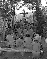 Chaplain Kenny Lynch conducts services north of Hwachon, Korea, for men of 31st Regt.  August 28, 1951.  Pvt. Jack D. Johnson. (Army)<br /> NARA FILE #  111-SC-378917<br /> WAR & CONFLICT BOOK #:  1463