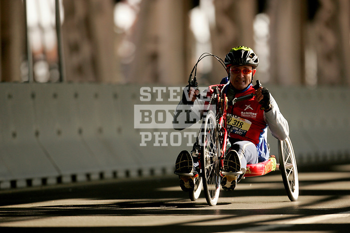 Mike Berry (USA) crosses the Queensboro bridge from Queens into Manhattan in his handcycle wheelchair during the ING New York City Marathon in New York, New York on November 4, 2007.  Alejando Albor (USA) won the race with a time of 1:17:48.