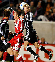 DC United defender Bryan Namoff (26) heads the ball over Chicago Fire forward Chad Barrett (9). The Chicago Fire defeated D. C. United 1-0 during the first leg of the MLS Eastern Conference Semifinal Series at Toyota Park in Bridgeview, IL, on October 25, 2007.