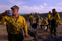 Military trained as firefighters break for the evening after smoldering hot spots at the Clear Creek wildfire.  ..More than a billion dollars is spent annually suppressing fires that burn millions of acres of western land... Though wildland fires play an integral role in many forest and rangeland ecosystems, decades of efforts directed at extinguishing every fire that burned on public lands have disrupted the natural fire regimes that once existed. ..Moreover, as more and more communities develop and grow in areas that are adjacent to fire-prone lands in what is known as the wildland/urban interface, wildland fires pose increasing threats to people and their property...