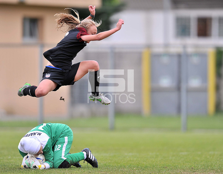 Monfalcone, Italy, April 26, 2016.<br /> USA's #9 Vatne jumps over Iran's goalkeeper Naffei during USA v Iran football match at Gradisca Tournament of Nations (women's tournament). Monfalcone's stadium.<br /> © ph Simone Ferraro / Isiphotos