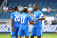 KANSASCITY, KS - JULY 11: Stephane Abaul #20 ,Burner Patrick #17 ,Sebastien Cretinoir #21 of Martinique during a game between Canada and Martinique at Children's Mercy Park on July 11, 2021 in KansasCity, Kansas.