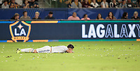 CARSON, CA - SEPTEMBER 21: Cristian Pavon #10 of the Los Angeles Galaxy gets knocked to the ground during a game between Montreal Impact and Los Angeles Galaxy at Dignity Health Sports Park on September 21, 2019 in Carson, California.