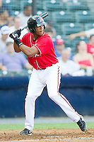 Sharlon Schoop #14 of the Richmond Flying Squirrels at bat against the Harrisburg Senators in game one of a double-header at The Diamond on July 22, 2011 in Richmond, Virginia.  The Squirrels defeated the Senators 3-1.   (Brian Westerholt / Four Seam Images)