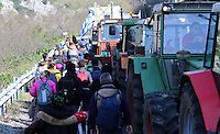 Pictured: Migrants walk on the motorway Thursday 25 February 2016<br />Re: Hundreds of migrants, including families with young children, that were stranded at Tempe in central Greece, were forced to walk on foot on the motorway to reach Idomen, about 168 kilometres away, in the northern part of the country, at the Greek FYRO Macedonian border. Local police were at first escorting them, then made sure that they were safely transported on coaches.