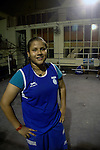 INDIA (West Bengal - Calcutta)August 2007,Shakila Babe  during practice at Sports Authority of India Complex (East Zone) in Kolkata. Shakila and Shanno are twins from a poor muslim family of Iqbalpur, Kolkata. . Inspite of their late father's unwillingness to send his daughters to take up  boxing her mother Banno Begum inspired them to take up boxing at the age of 3. Their father was more concerned about the social stigma they have in their community regarding women coming into sports or doing anything which may show disrespect to the religious emotions of his community. Shakila now has been recognised as one of the best young woman boxers of the country after she won the  international championship at Turkey in the junior category. Shanno is also been called for the National camp this year. Presently Shakila and shanno has become the role model in the Iqbalpur area  and parents from muslim community of Iqbalpur have started showing interst in boxing. Iqbalpur is a poor muslim dominated area mostly covered with shanty town with all odds which comes along with poverty and lack of education. - Arindam Mukherjee