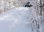 Volvo XC70 car on a snow covered unpaved country road, winter nature scenic. Image © MaximImages, License at https://www.maximimages.com