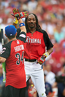 Rapper Snoop Dogg high fives Wounded Warrior Tim Horton (34) during the All-Star Legends and Celebrity Softball Game on July 12, 2015 at Great American Ball Park in Cincinnati, Ohio.  (Mike Janes/Four Seam Images)