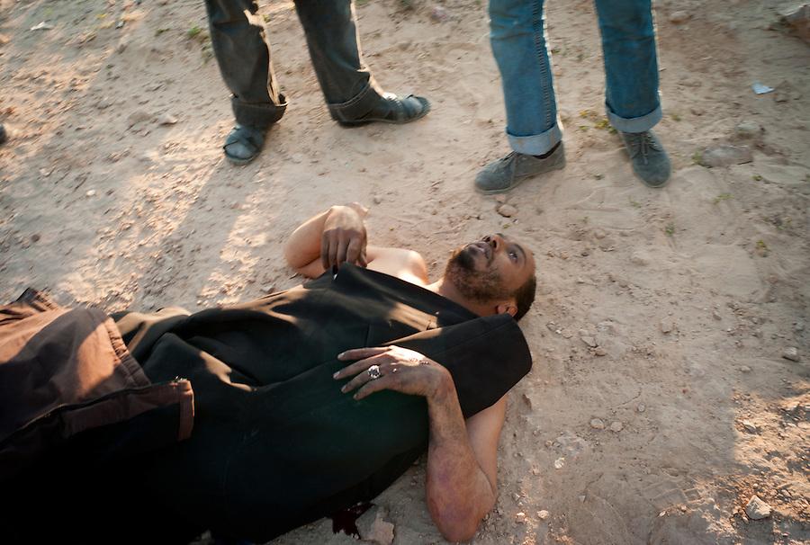 Rebel casualty otuside Ajdabiya, Libya.