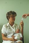 Premature Baby Unit Nottingham General Hospital, nurse feeding. 1980s UK